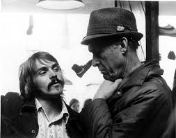 Coach Bill Bowerman (th), her med Steve Prefontaine